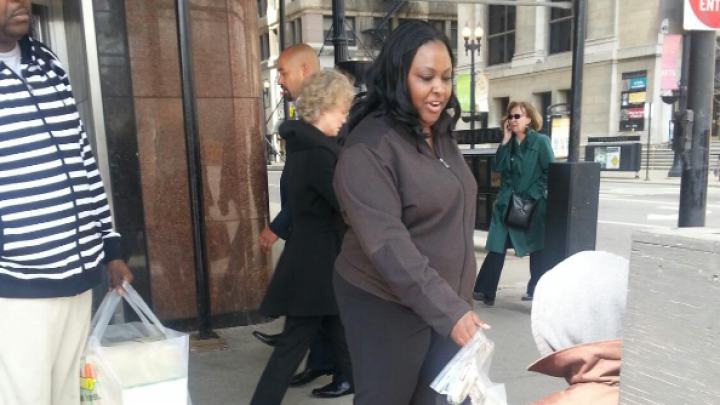 Woman providing food for individuals experiencing homelessness