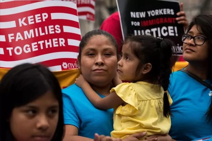 A mother holds her child amidst a pro-immigrant march