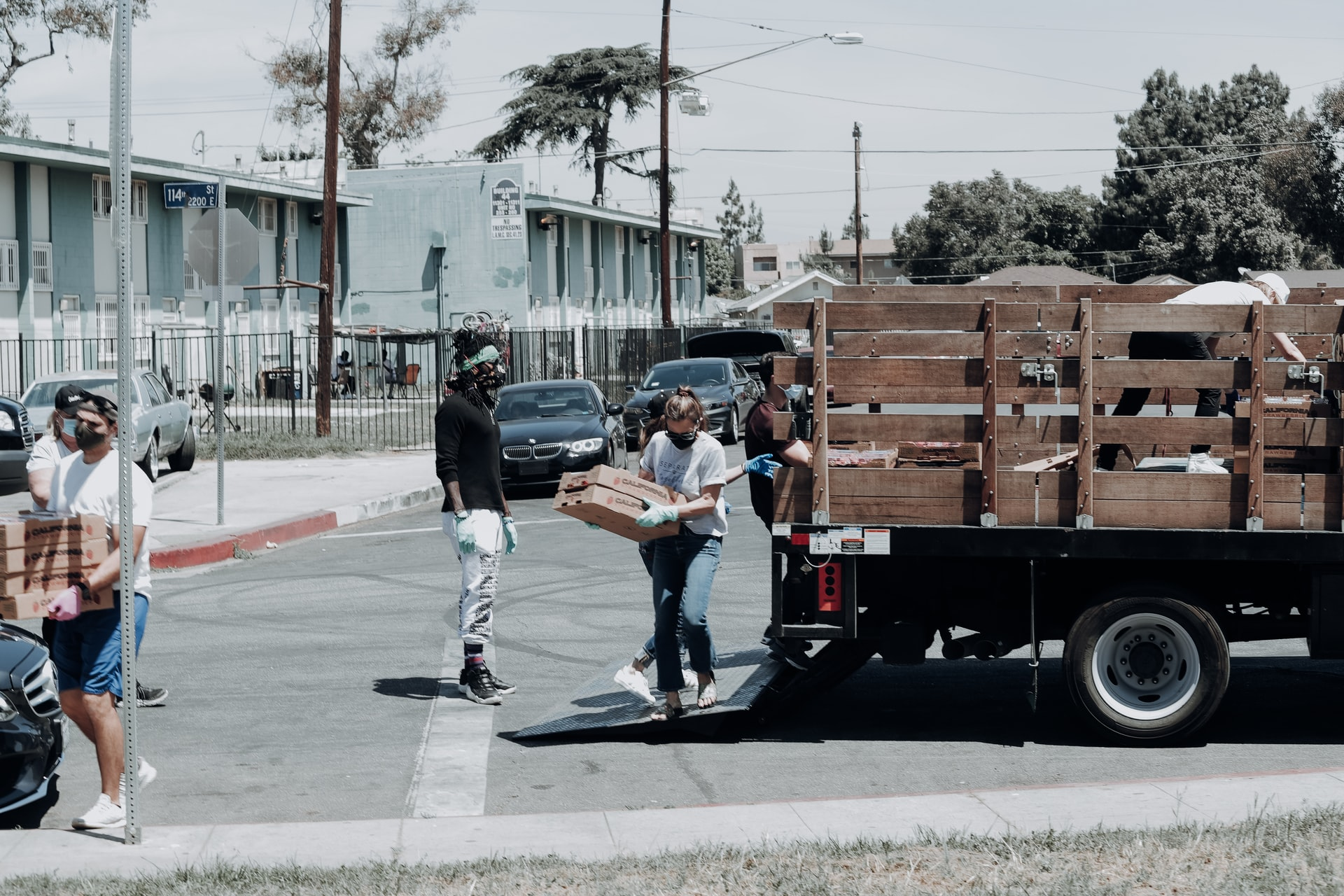 person carrying boxes from truck