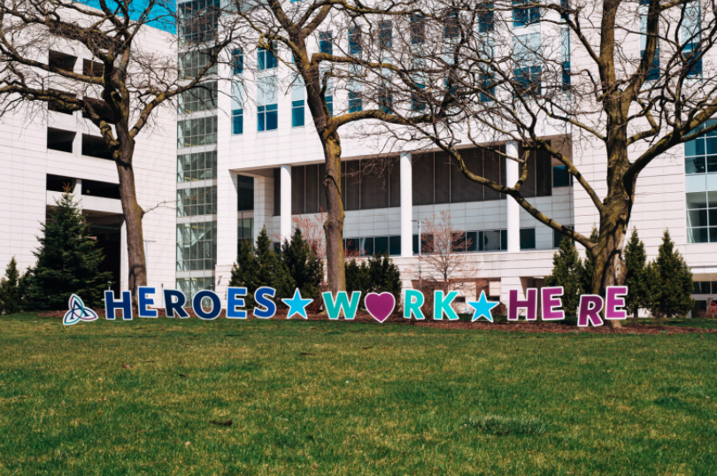 heroes work here sign in front of a hospital