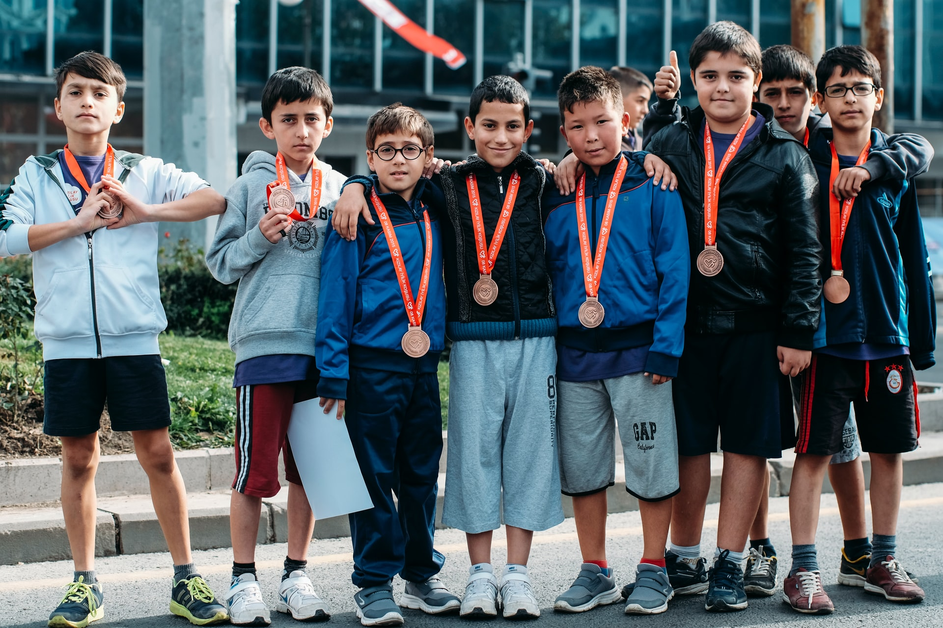 children with medals around their neck