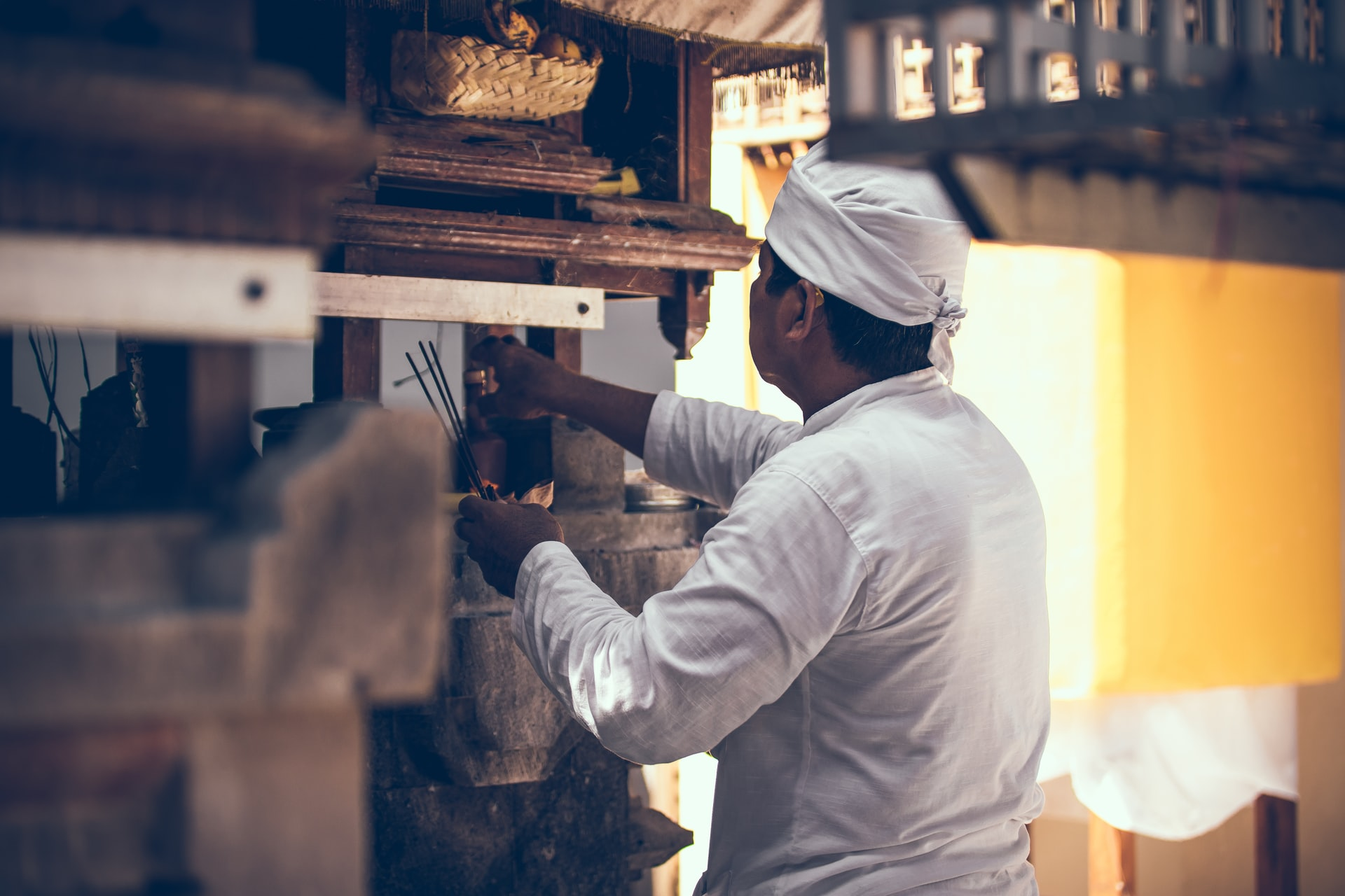 man wearing a chef outfit working in a restaurant