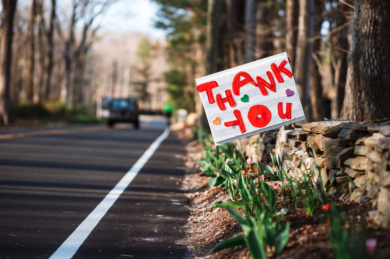 thank you sign for essential workers on the side of the road