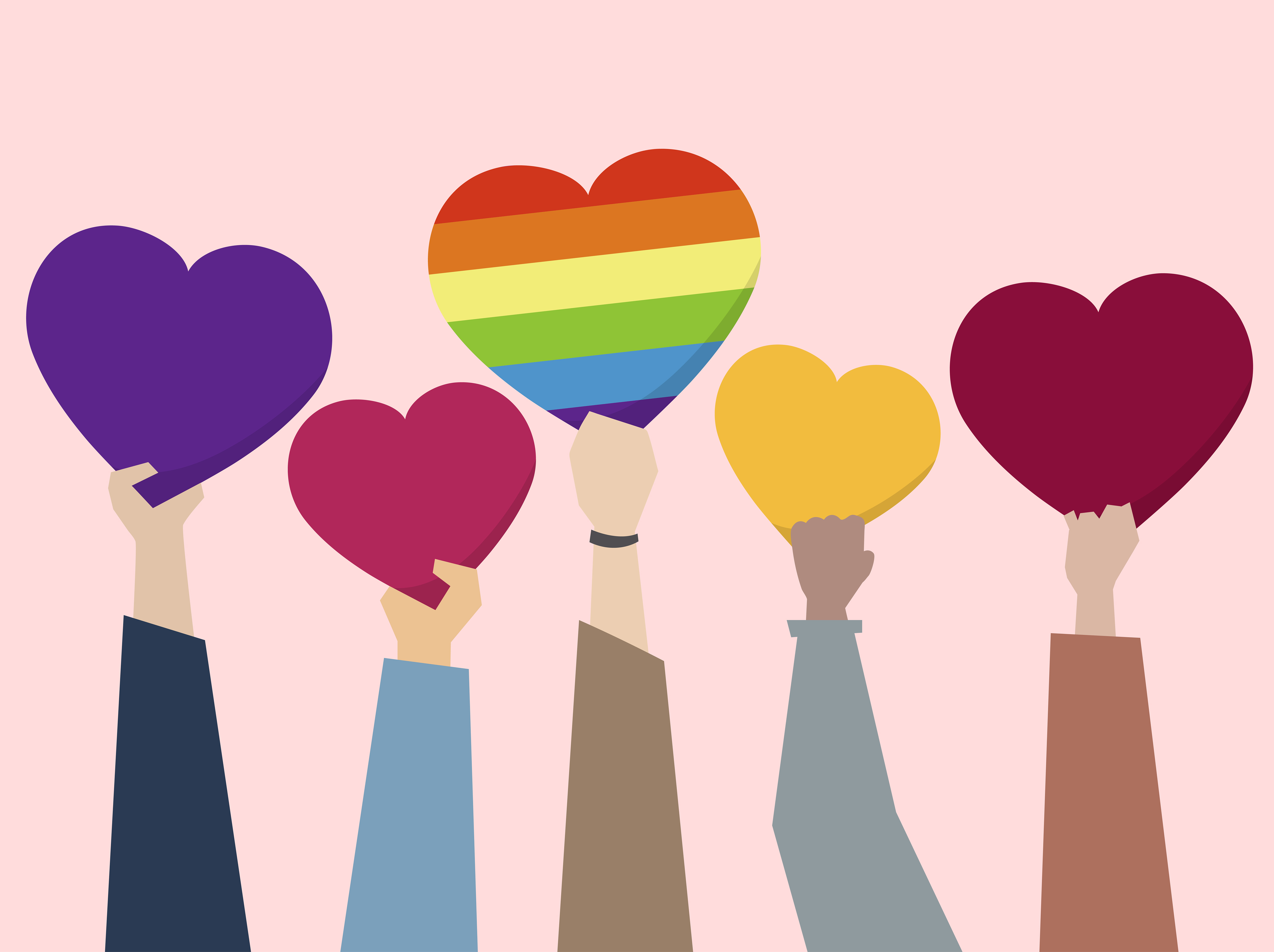 People holding up hearts