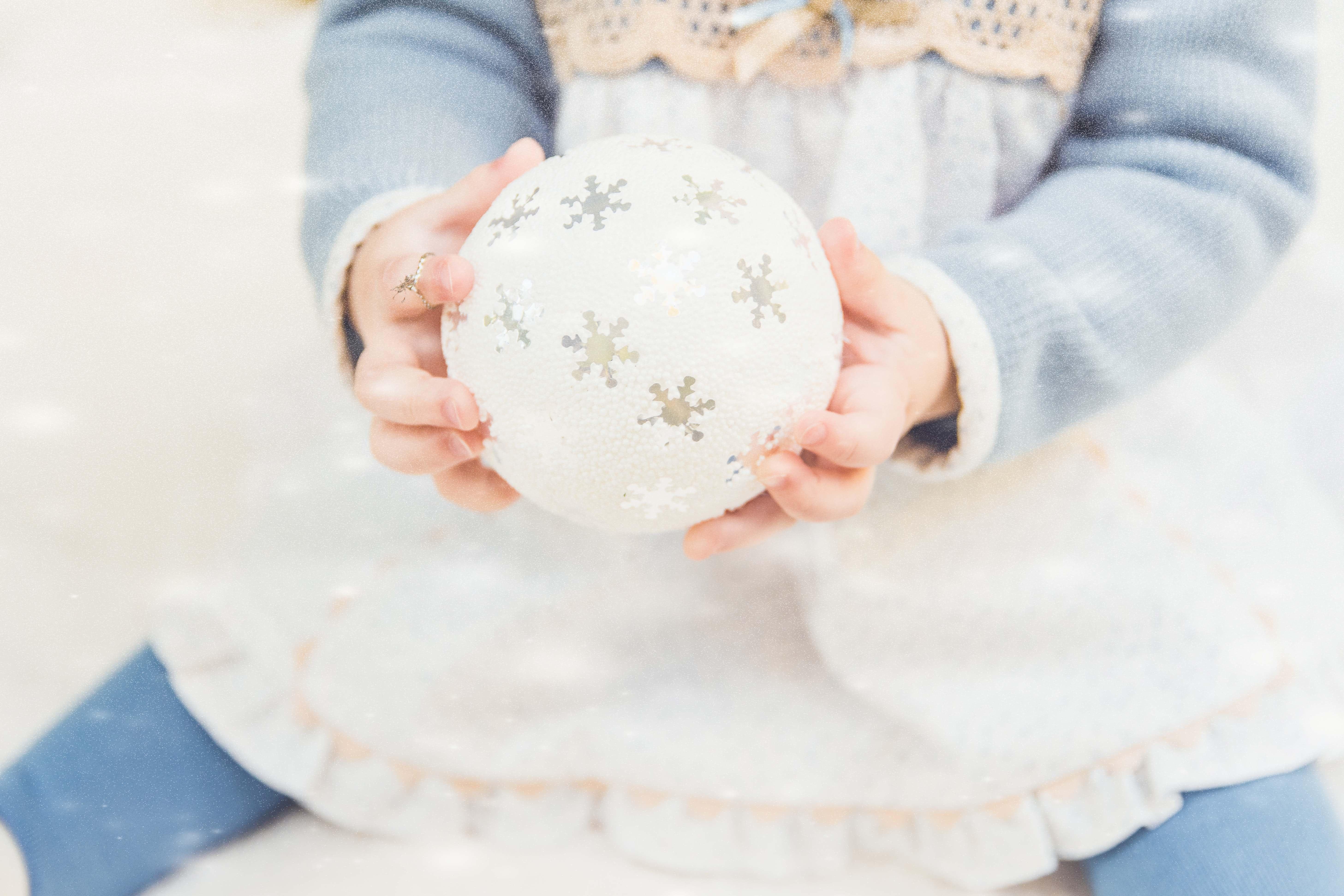 Little girl holding baubel