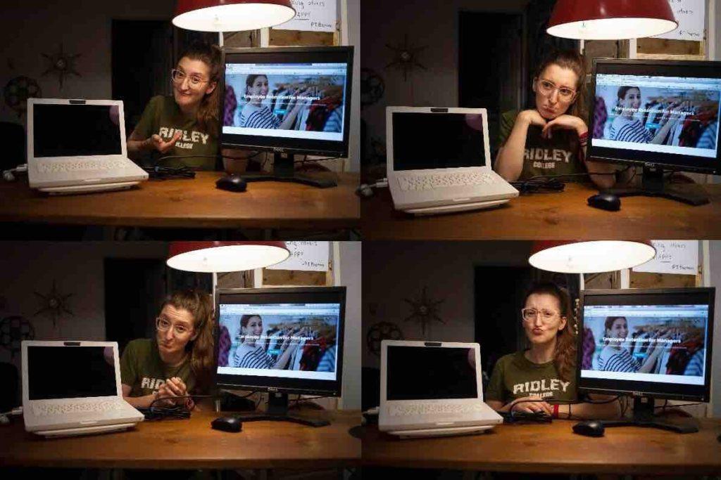 Femme posant avec un ordinateur
