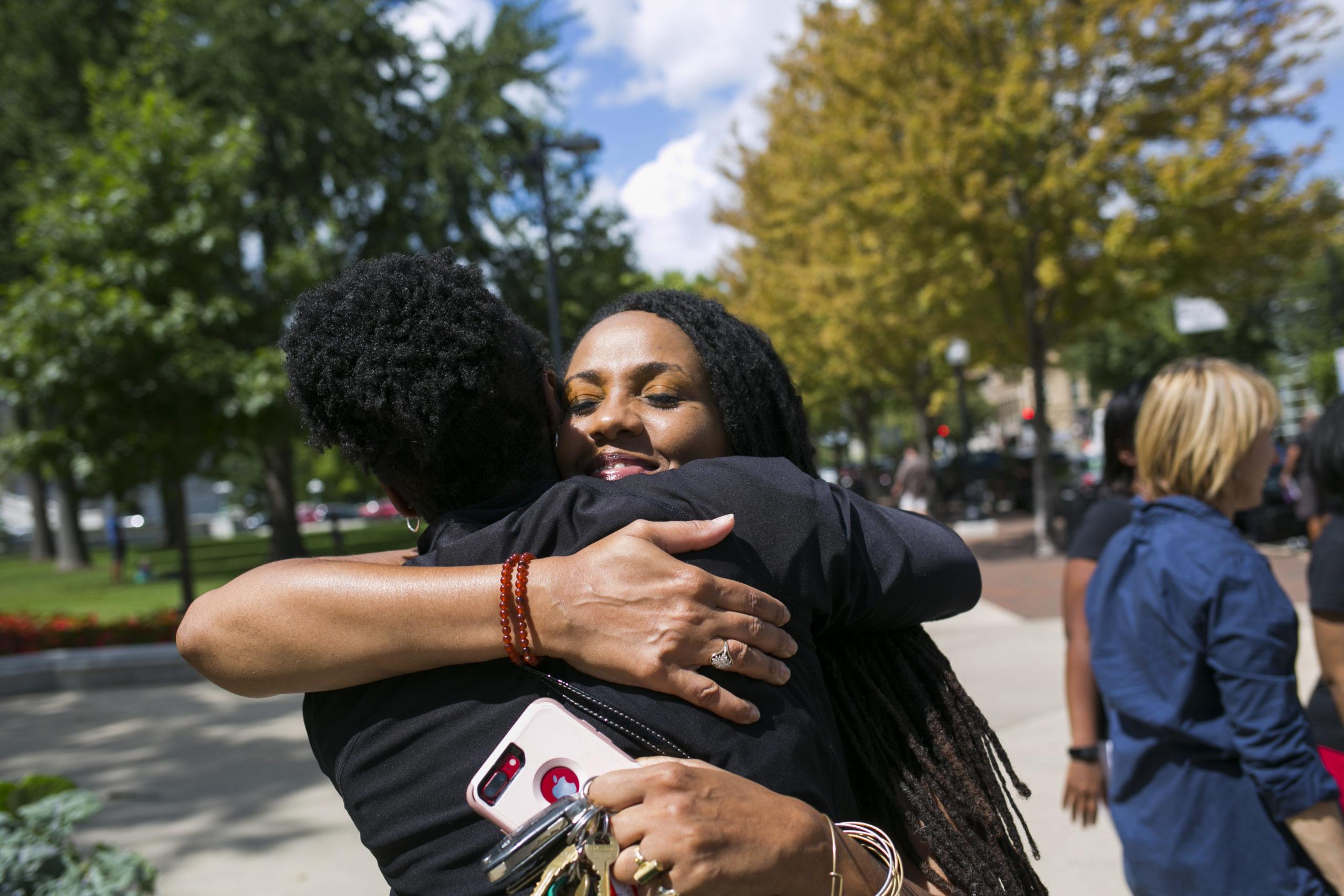 Two women hugging in the street