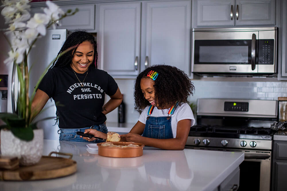 woman and girl at kitchen counter
